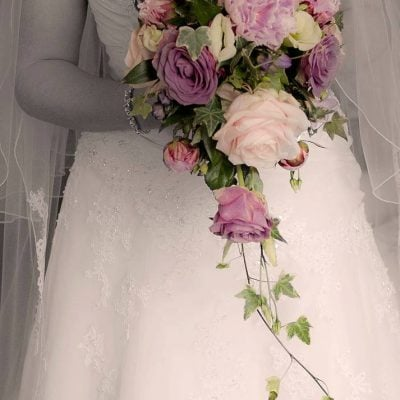 Sweet Avalanche roses running through this bouquet. Photo by The Balloon Lady