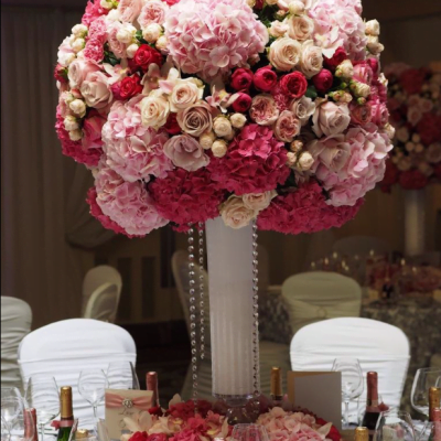 Sweet Avalanche byMeijer Rosesfeatures in a stunning pink floral design byNeill Strain Floral Couture London! (photo by John Nassari)