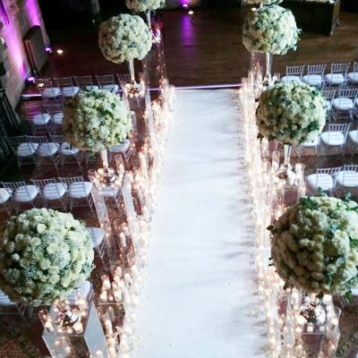 The great Hall at the Peckforton Castle styled by Red Floral Architecture with Avalanche roses.