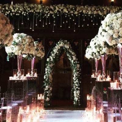 The Great Hall of the Peckforton Castle styled by Red Floral Architecture with Avalanche roses