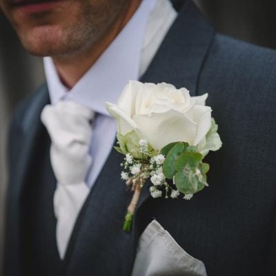 Groom's buttonhole made with Avalanche Rose, lisianthus and gypsophilia.