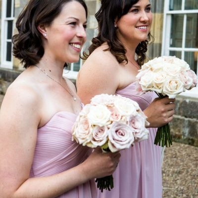 Happy bridesmaids with bouquets full of Sweet Avalanche.